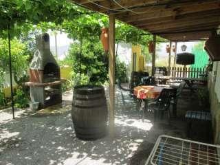 patio bij vakantiewoning zon en uitzicht