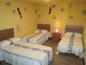 tweede slaapkamer met 3 bedden